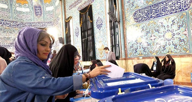 İran kritik seçim için sandık başında