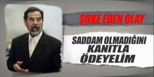 'Saddam Hüseyin olmadığını kanıtla ödeyelim'