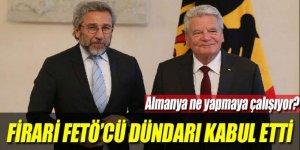 Gauck hakkında yakalama kararı olan firari FETÖ'cü Dündar'ı kabul etti!