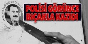 Polisi gören kadın Öcalan çıkarmasını bıçakladı kazıdı