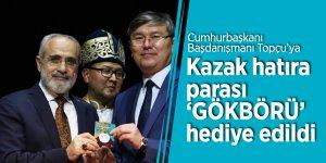 Cumhurbaşkanı Başdanışmanı Topçu'ya Kazak hatıra parası 'GÖKBÖRÜ' hediye edildi